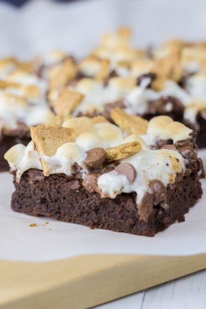 These rich, fudgy, and chewy S'more Brownies are loaded with marshmallow, chocolate chips, and graham crackers. It is an easy chocolate dessert that is perfect for the holiday season.