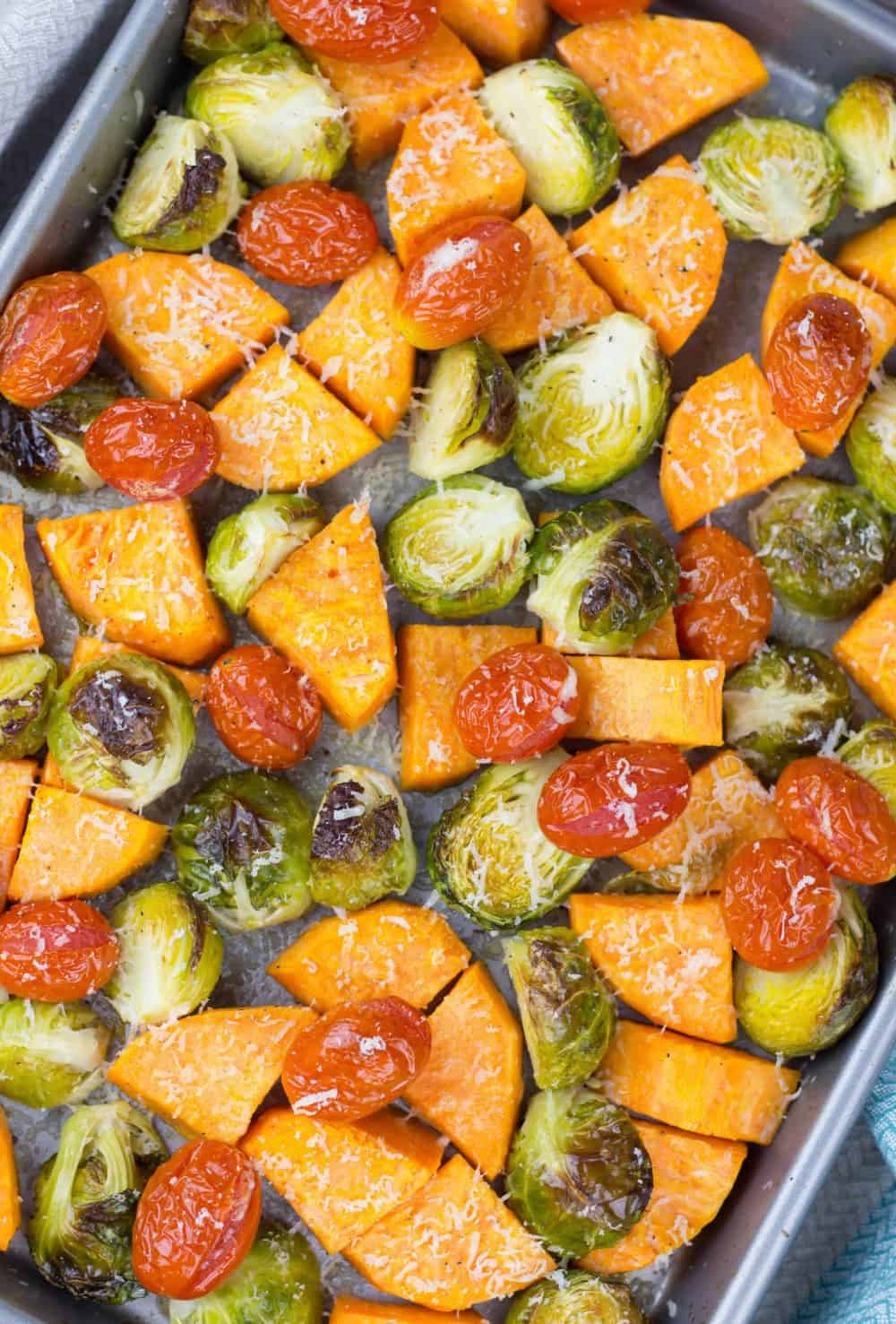 Roasted Brussel Sprouts, Sweet potato, and Cherry Tomatoes is a great vegetarian side dish recipe for any occasion. Quick and easy dinner can be nutritious and delicious!