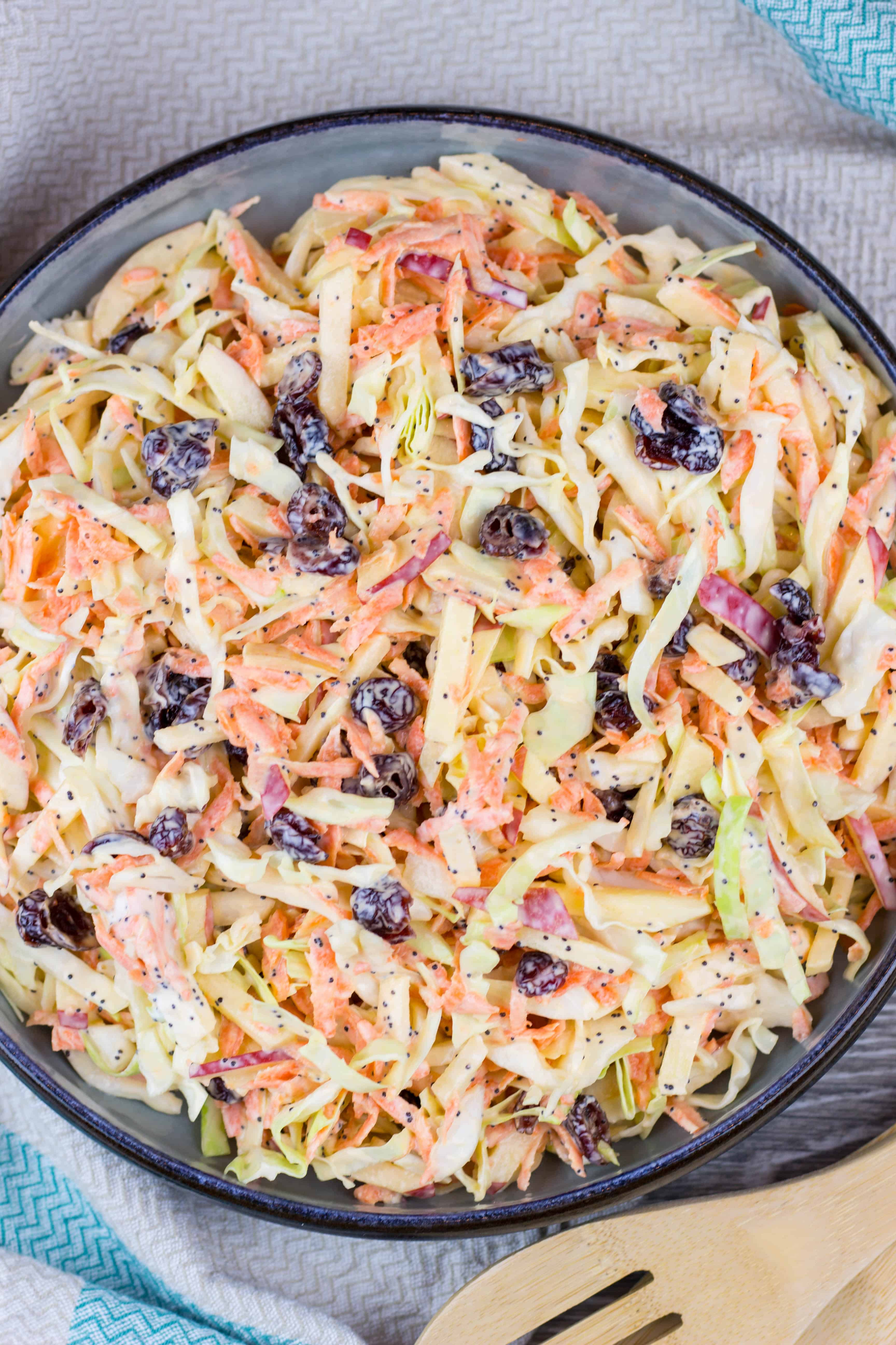 Apple Cranberry Coleslaw salad with creamy Greek yogurt dressing is a perfectly refreshing, crunchy side dish that can be served with just about anything, from pulled pork sandwiches to fried fish, or a nice juicy burger.