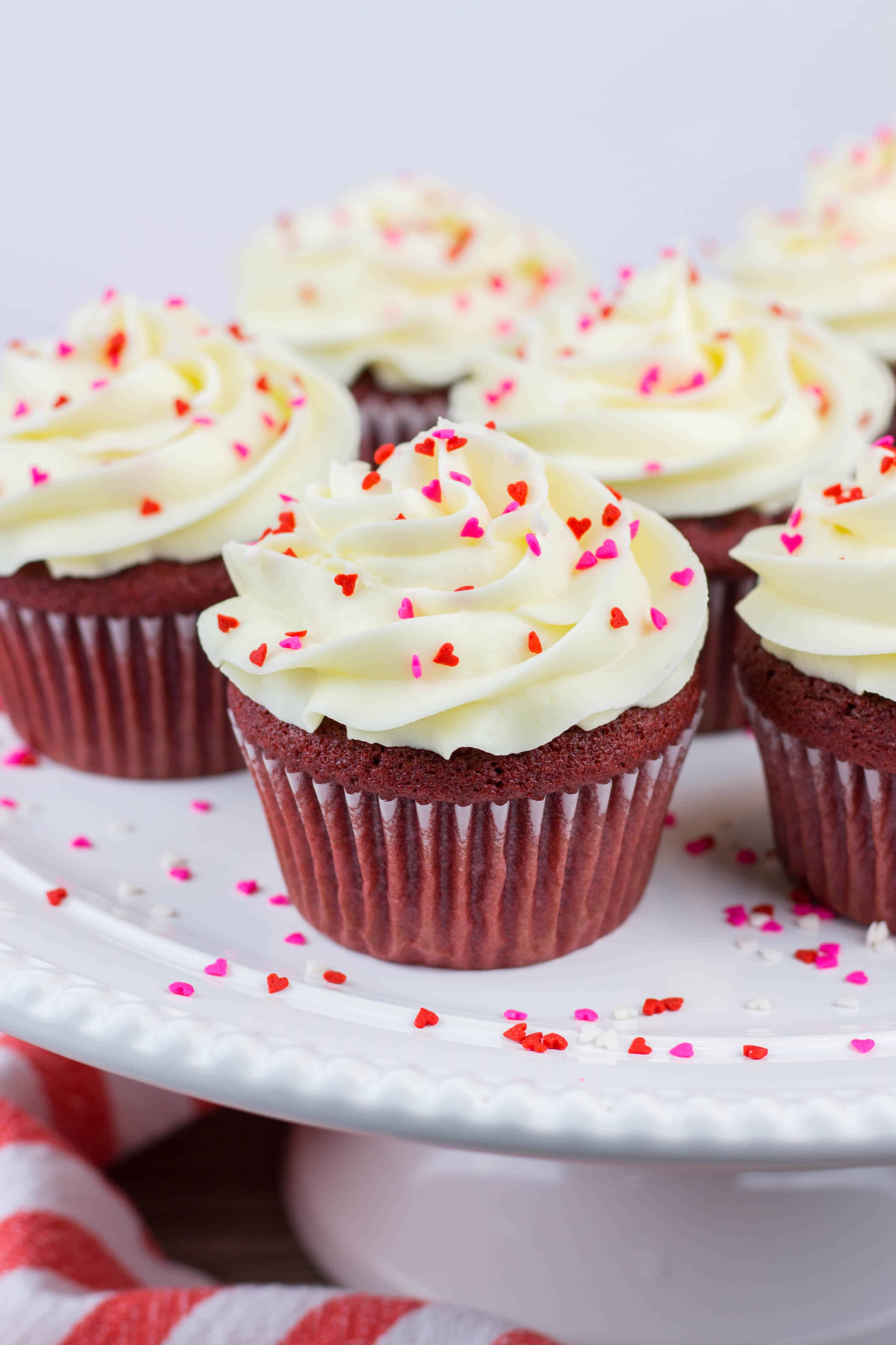 Red Velvet Cupcakes with cream cheese frosting is a perfect St. Valentine's Day recipe to surprise your loved ones. These easy to make from scratch cupcakes will become your favorite!