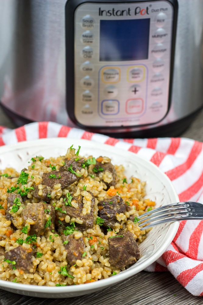 Instant Pot Brown Rice Pilaf recipe is an easy to make version of a classic Beef Plov. With perfectly cooked rice and tender and juicy beef tips, it is a great All-in-One-Pot comfort meal!
