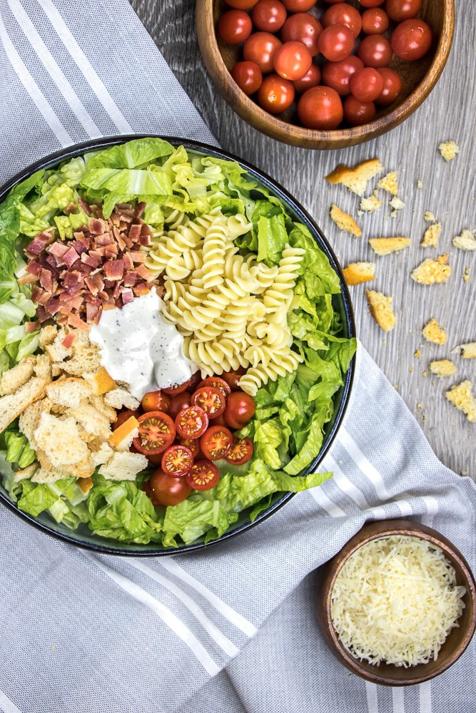 BLT Pasta Salad is an easy summer party recipe to enjoy at your BBQ cookout. It includes lots of lettuce, cherry tomatoes, bacon, parm, and of course, pasta!