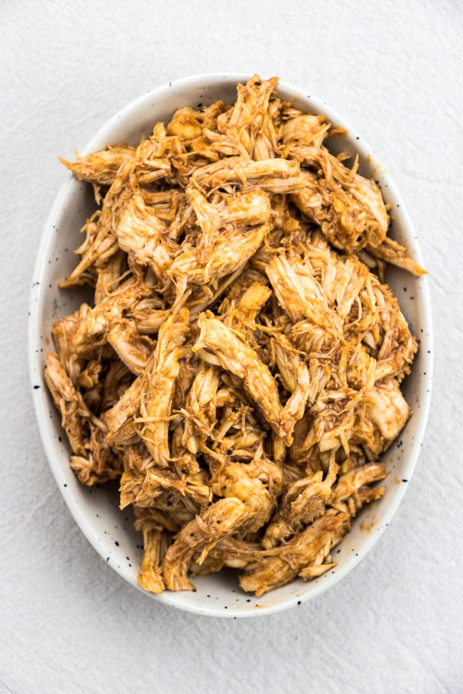 Instant Pot BBQ Pulled Chicken recipe is a quick and easy dinner idea that you can use in different meals, like tacos, sandwiches, or even meal prep.