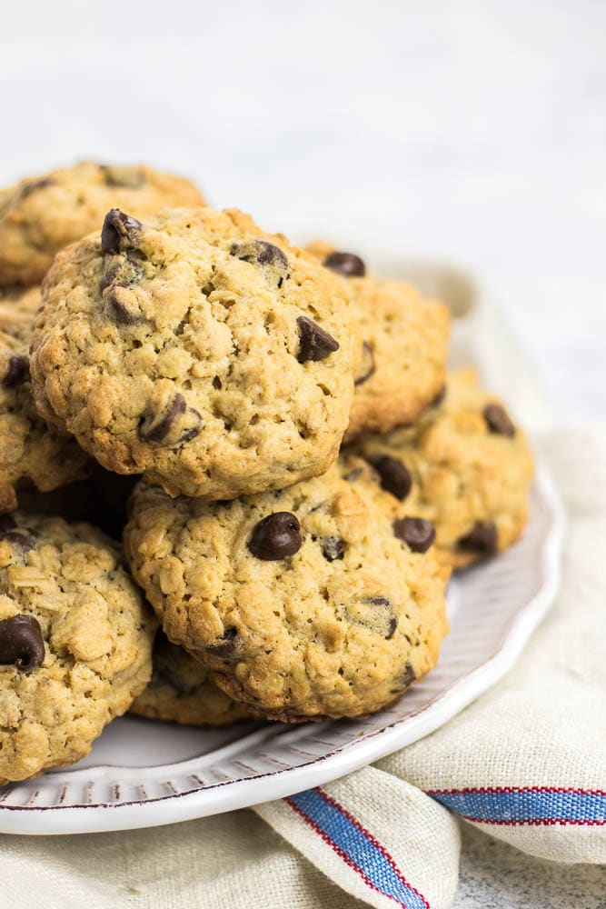 Thick and chewy Oatmeal Chocolate Chip Cookies are perfectly crispy outside and soft inside. Loaded with old fashion oats and chocolate chips, these delicious cookies are the best!