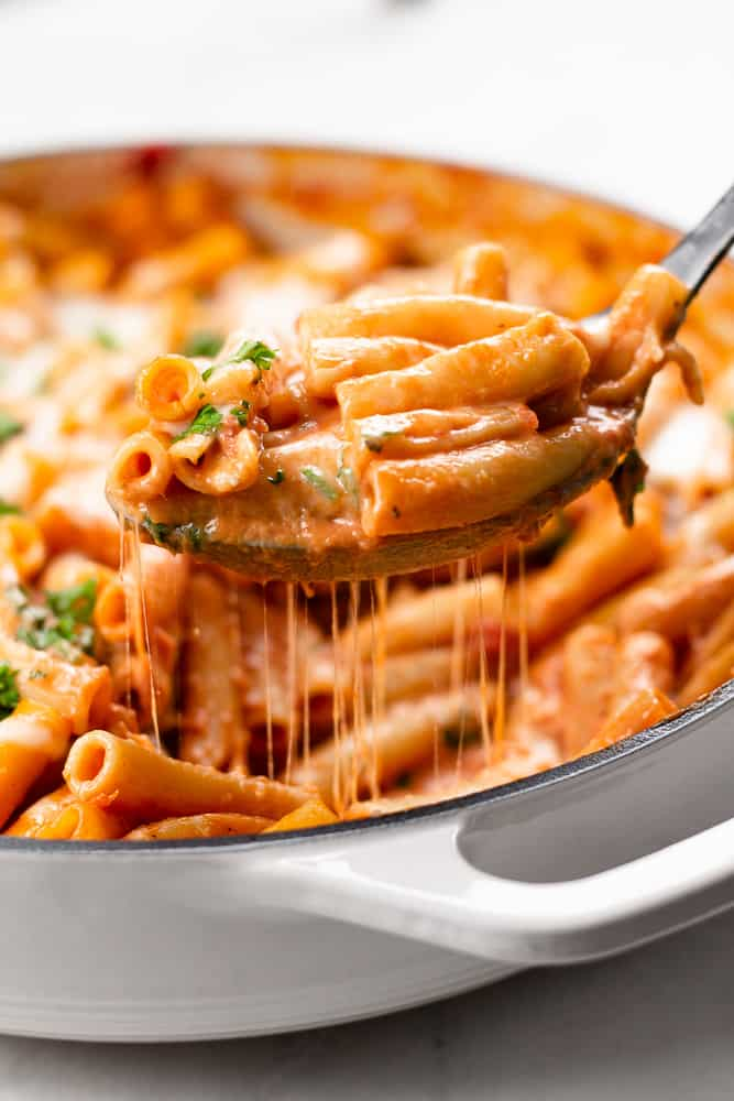 Easy Cheesy Baked Ziti in white skillet.
