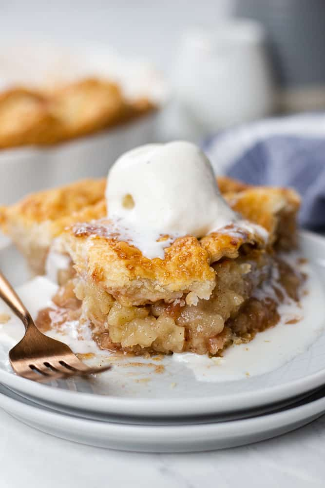 a slice of a Classic Apple Pie on a plate.