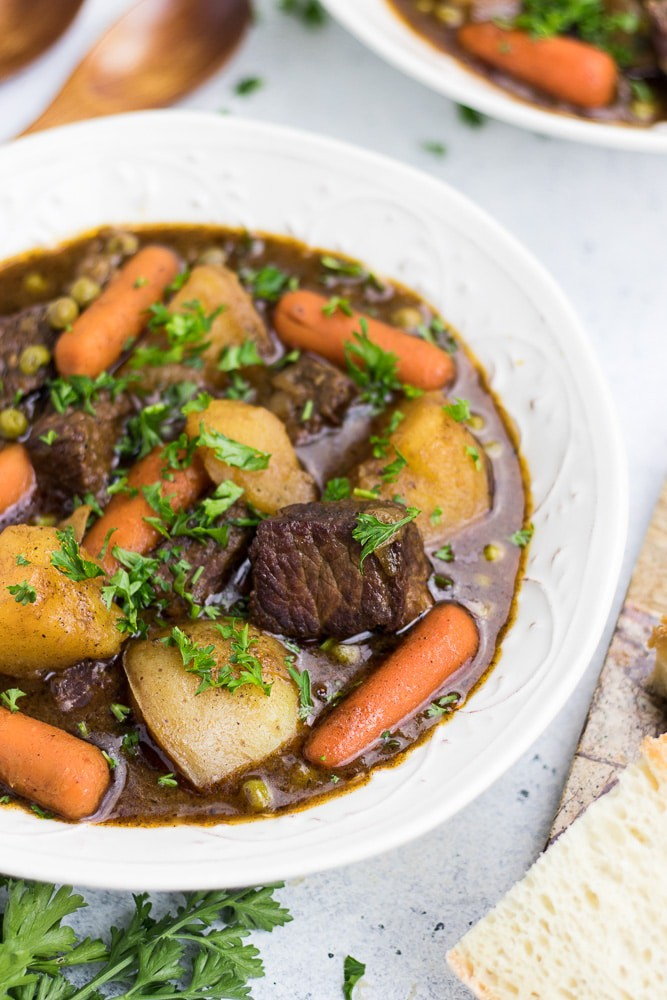 Dutch Oven Beef Stew recipe is an easy classic homemade comfort meal cooked on a stove top.