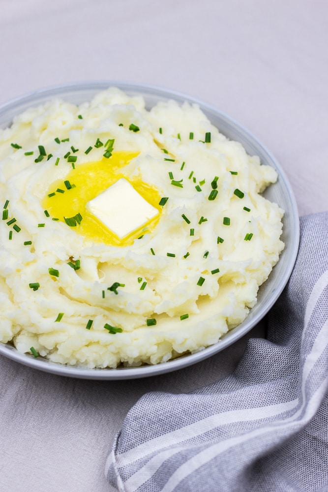Instant Pot Mashed Potatoes is the best easy homemade creamy side dish for a crowd during the holiday season!