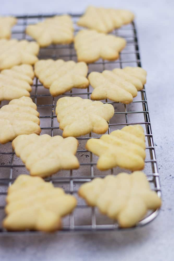 Almond Spritz Cookies recipe made with a cookie press is a classic treat for Christmas. This soft and buttery dessert is super easy to make to celebrate the Holiday Season!