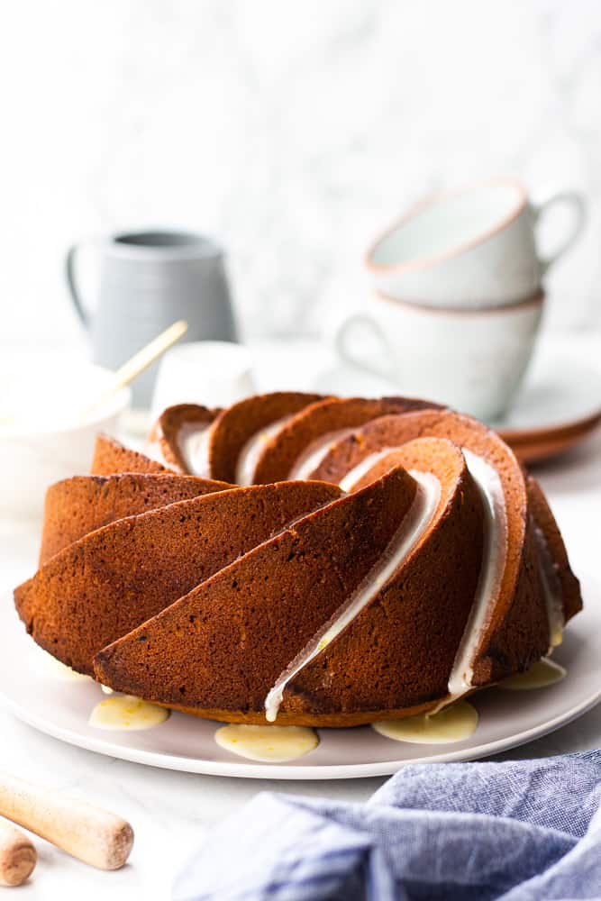 Orange Pound Cake on a light grey plate.