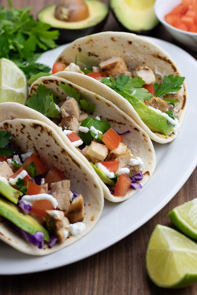 Let's celebrate the Big Game with healthy Grilled Chicken Tacos! This recipe is super easy to make and has so much flavor to please any crowd!