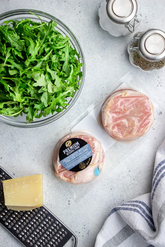 Bacon-Wrapped Pork Medallions with Arugula Salad, lemon, and Parmesan cheese is a great 30 minutes meal for a busy weeknight!