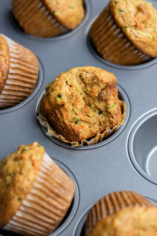 Freshly baked Carrot Zucchini Muffins in a muffin tin.
