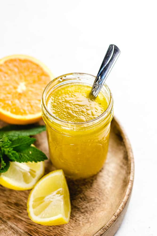 Close up shot of Citrus Vinaigrette in a mason jar.