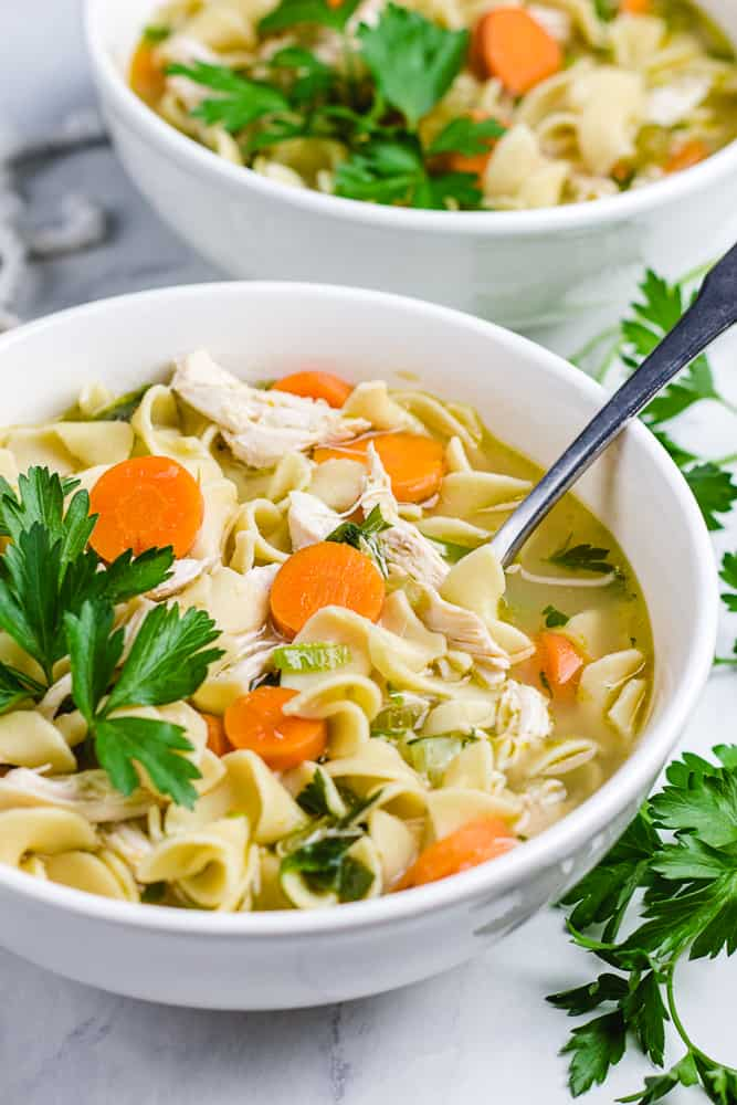 Chicken Noodle Soup in a white bowl.