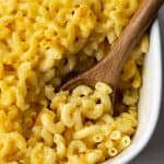 Creamy mac and cheese in a white baking pan