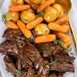 Pot Roast with Potatoes and Carrots on a white serving plate