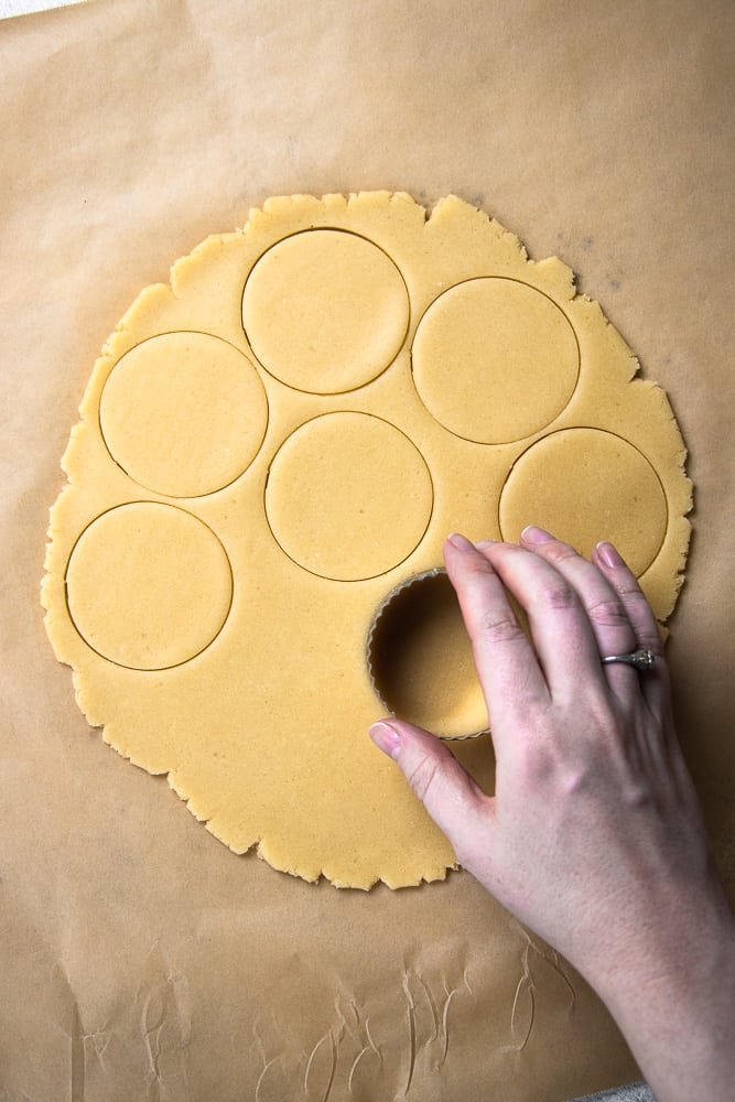 cutting out the cookies dough for Twix Cookies