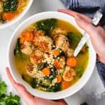 Italian Wedding Soup turkey with meatballs, acini de pepe pasta, and spinach in a white bowl.