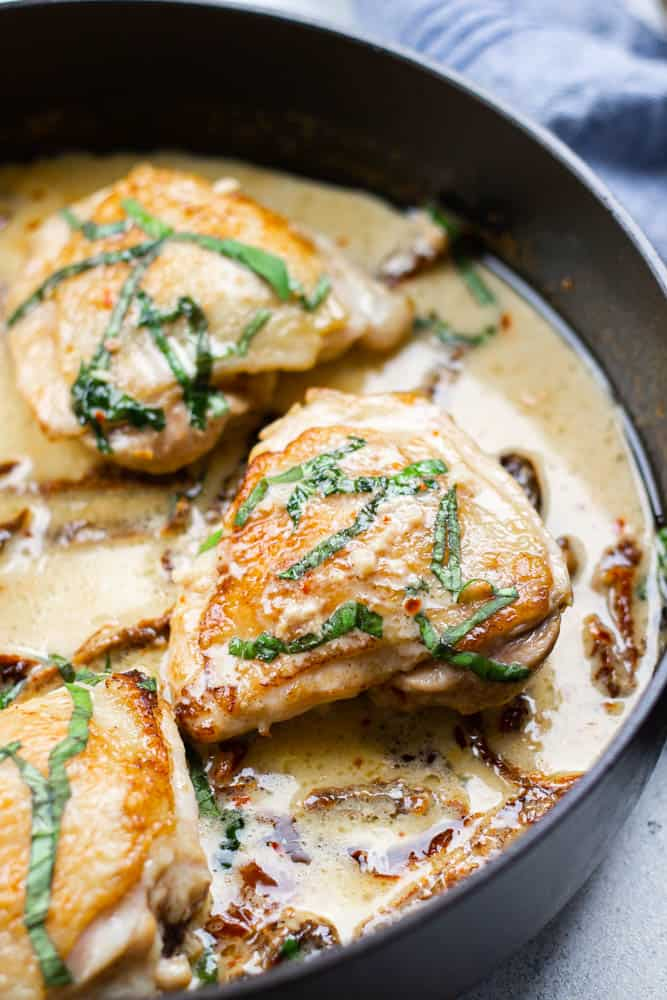 Chicken thighs in creamy sauce wtih sundried tomatoes.