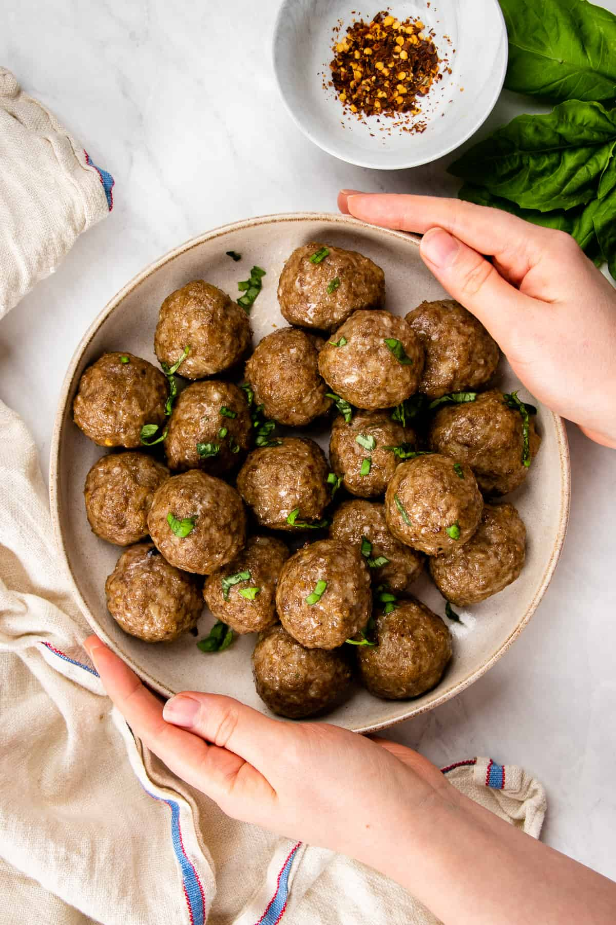 Cooked meatballs served on a plate.