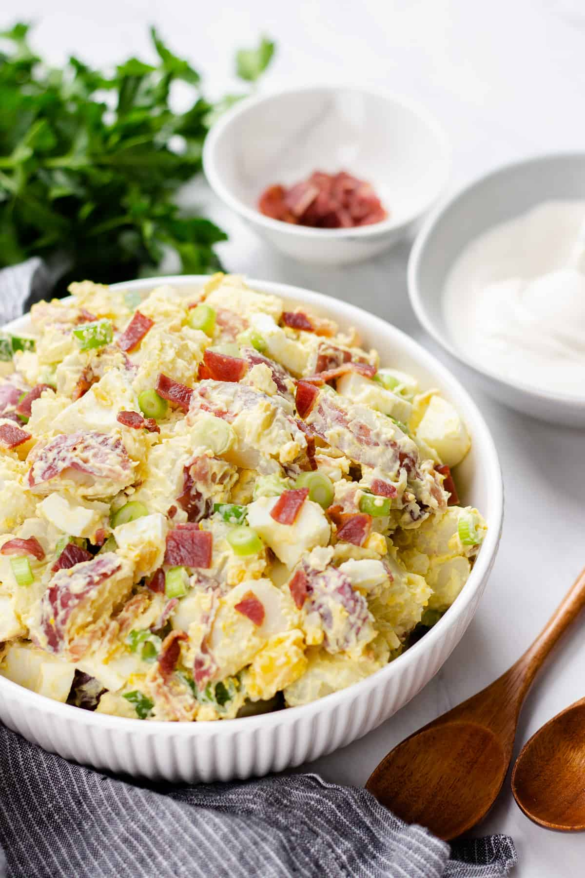 Potato Salad with Bacon and Egg in a white bowl.