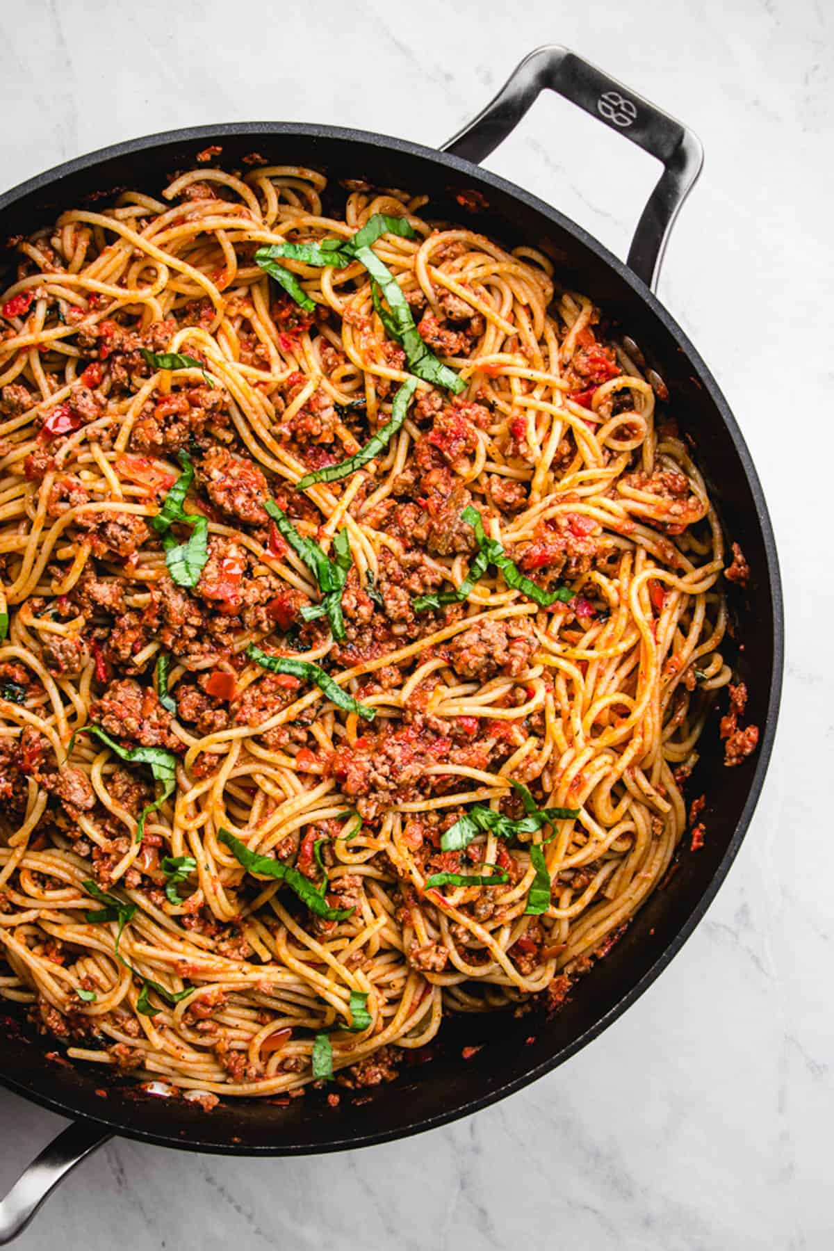pasta with meat sauce in a skillet.