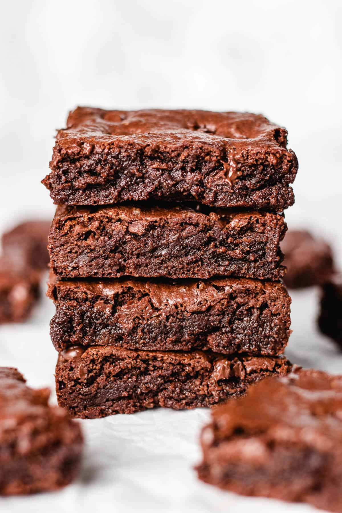 Squares of brownie on top of each other.