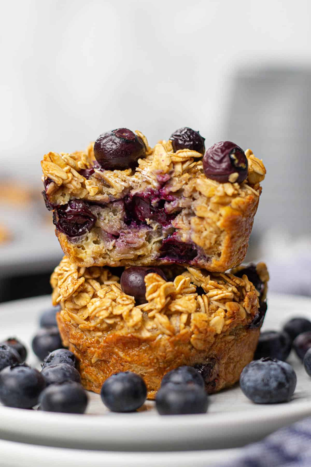 Oatmeal cups with blueberries on a plate.