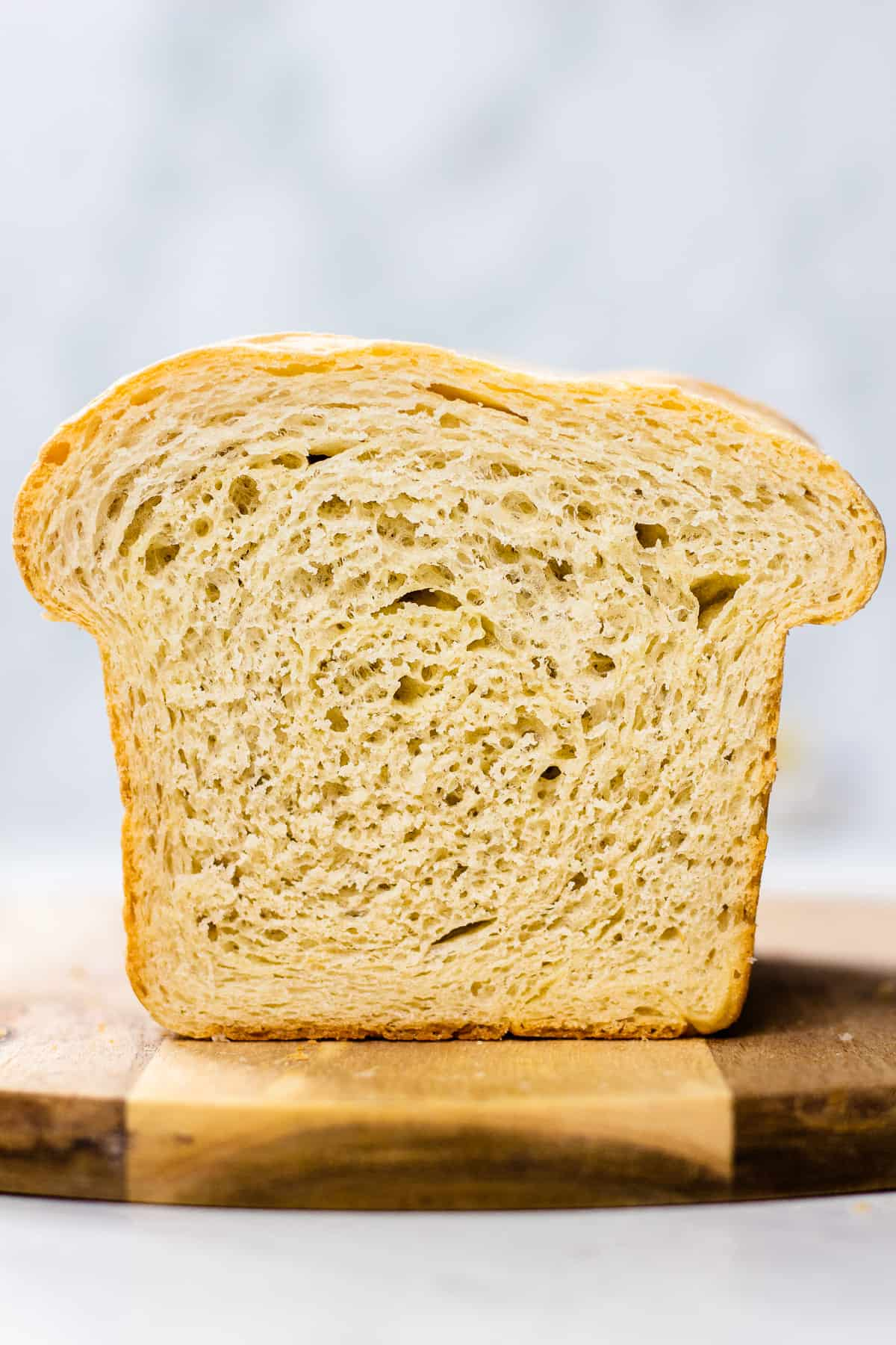 A close up photo of a cut white sandwich bread.