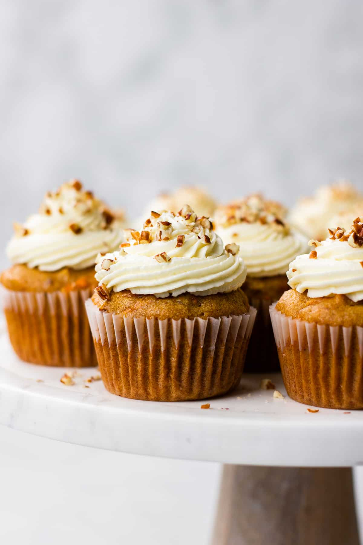Carrot Cake Cupcakes topped with Cream Cheese Frosting on a serving platter.