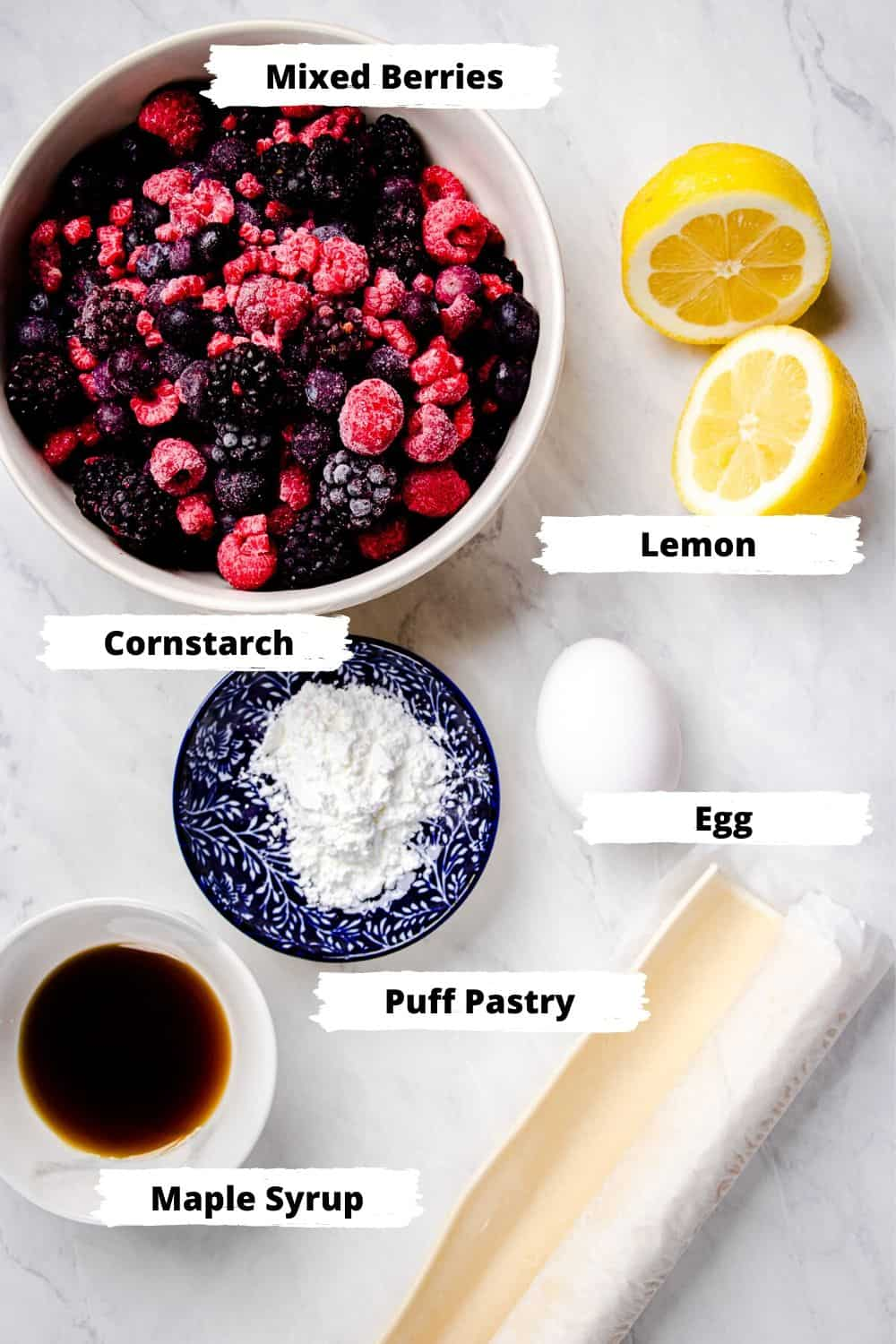 Ingredients for puff pastry tarts with mexed berries.