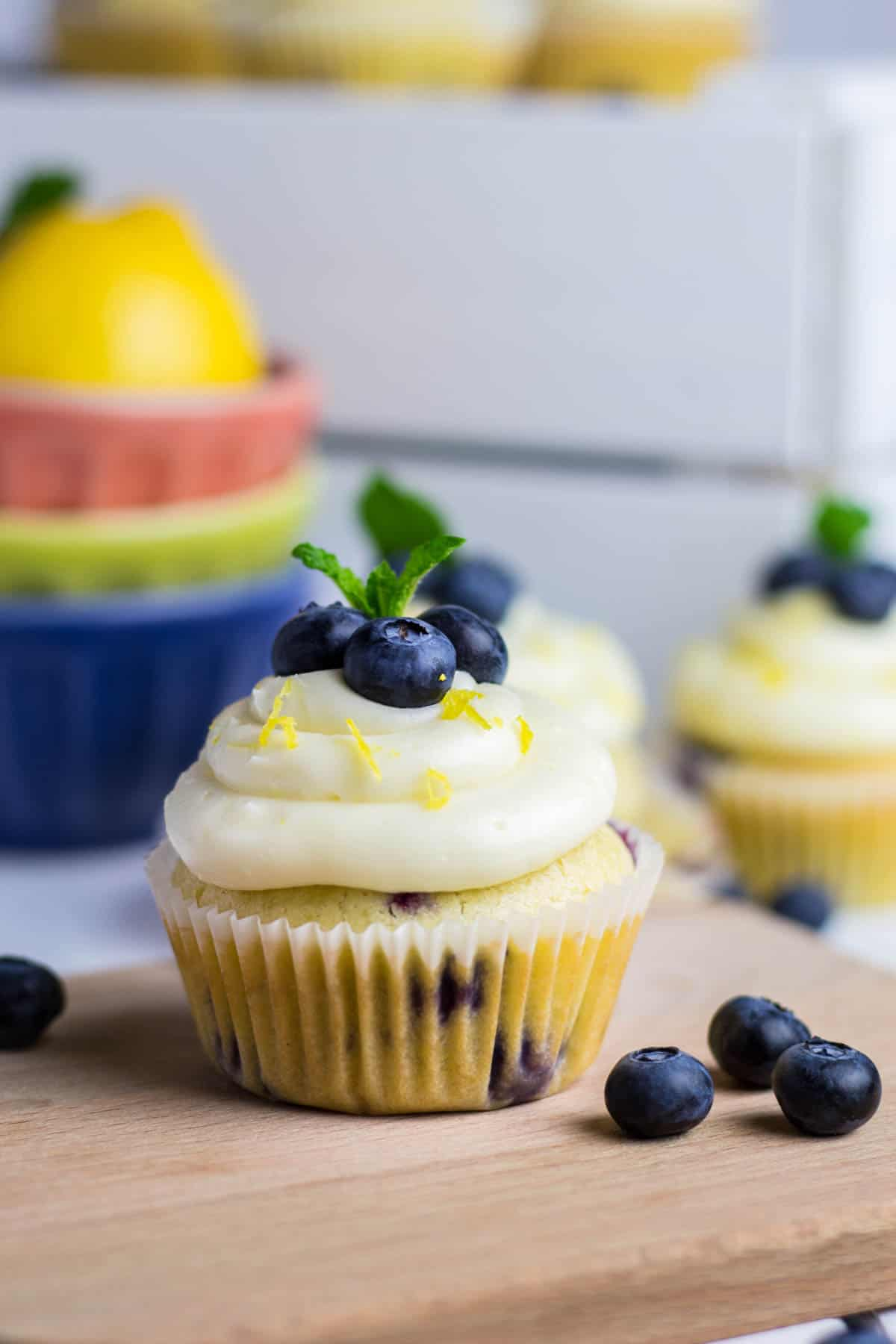 Blueberry Lemon Cupcakes toped with Cream Cheese Frosting and fresh blueberries