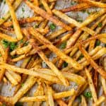Baked fries on a baking sheet.