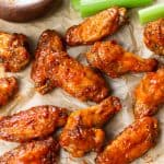 Buffalo chicken wings on a parchment paper.