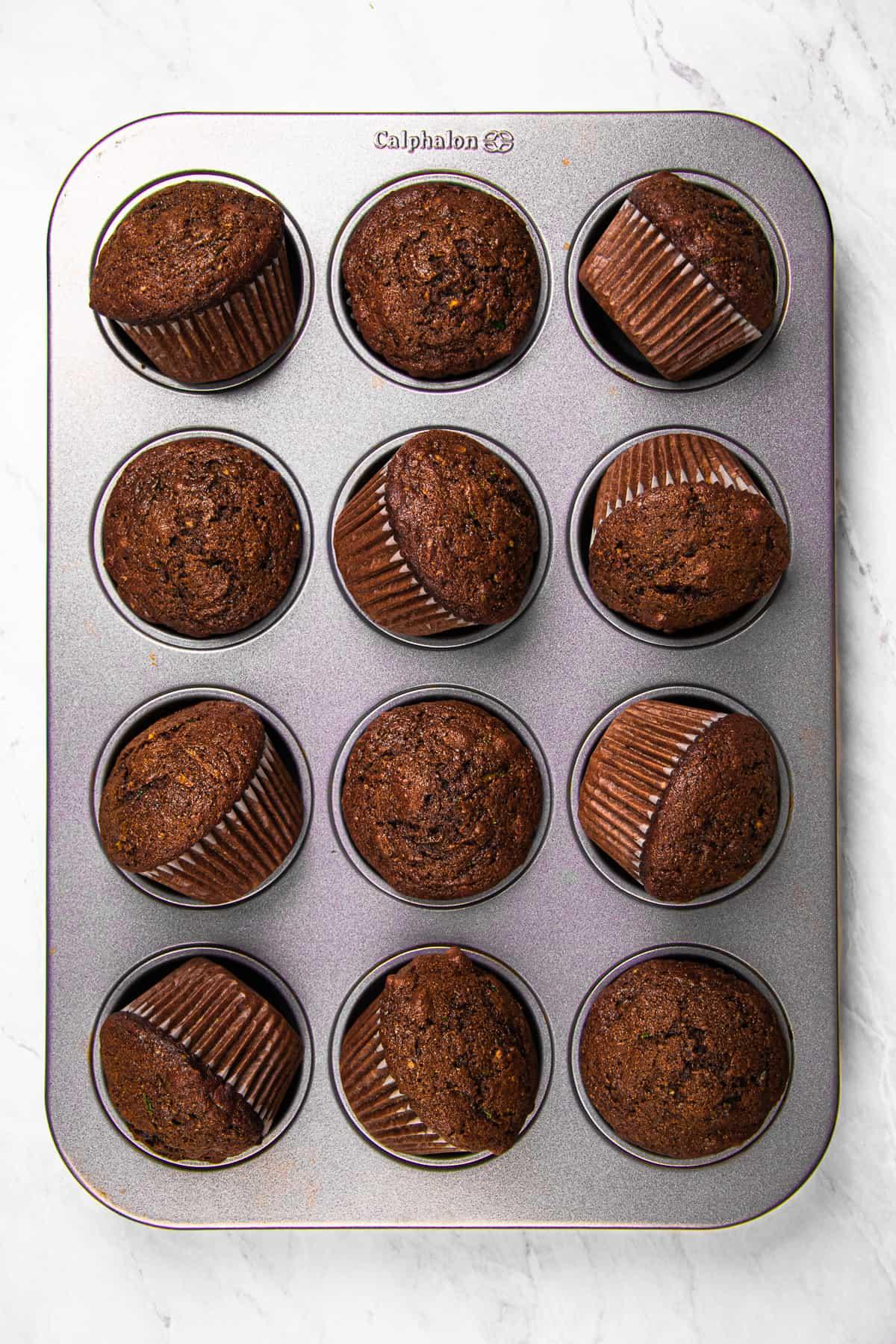 Chocolate Zucchini Muffins in a baking pan.