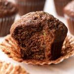 A bite shot of a chocolate zucchini muffins.