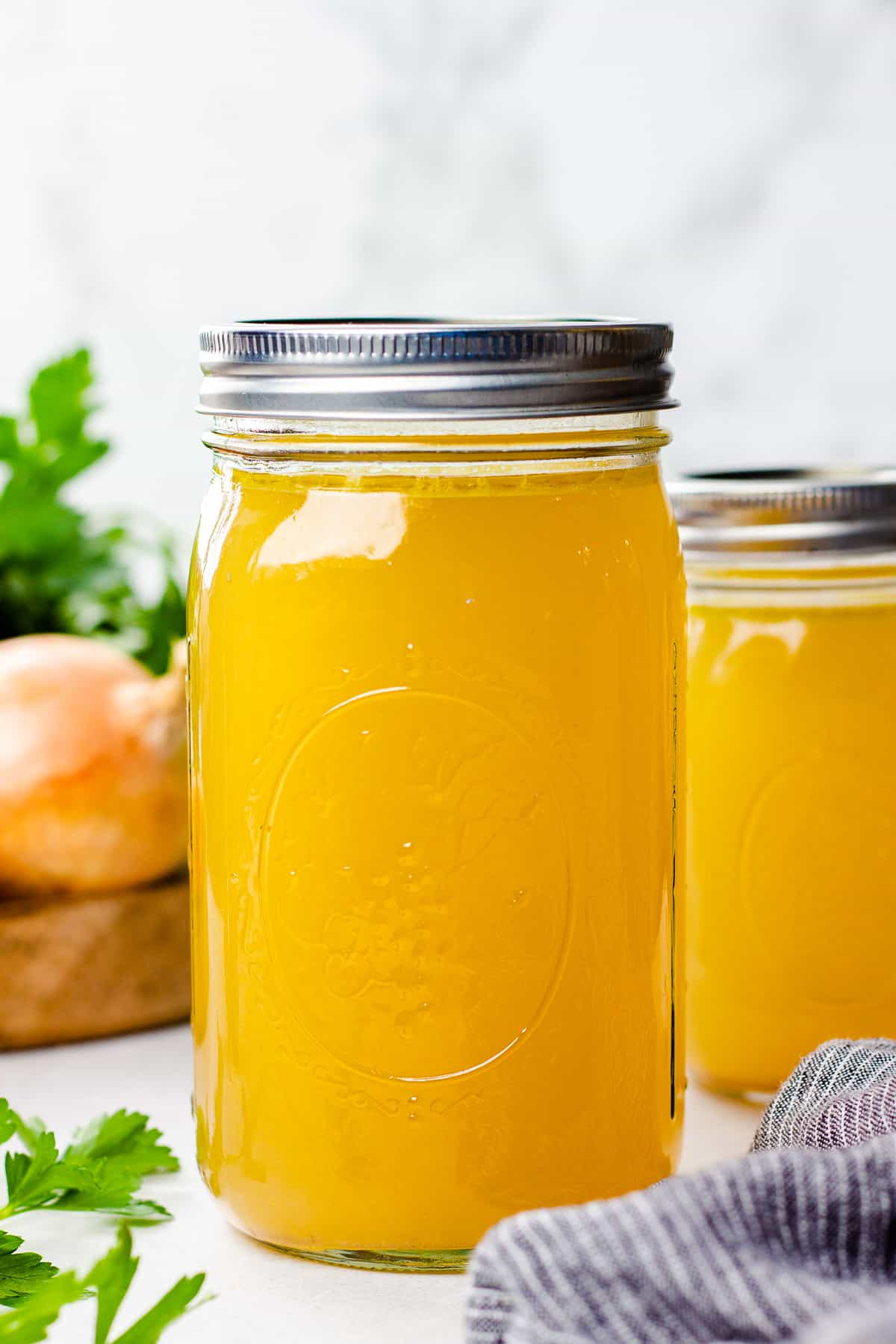 Homemade Chicken Stock in Mason jars.