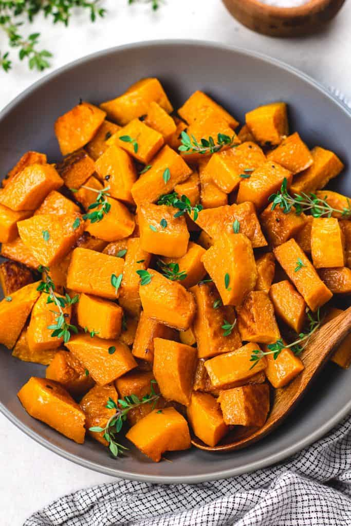 Roasted butternut squash in a dark grey bowl.