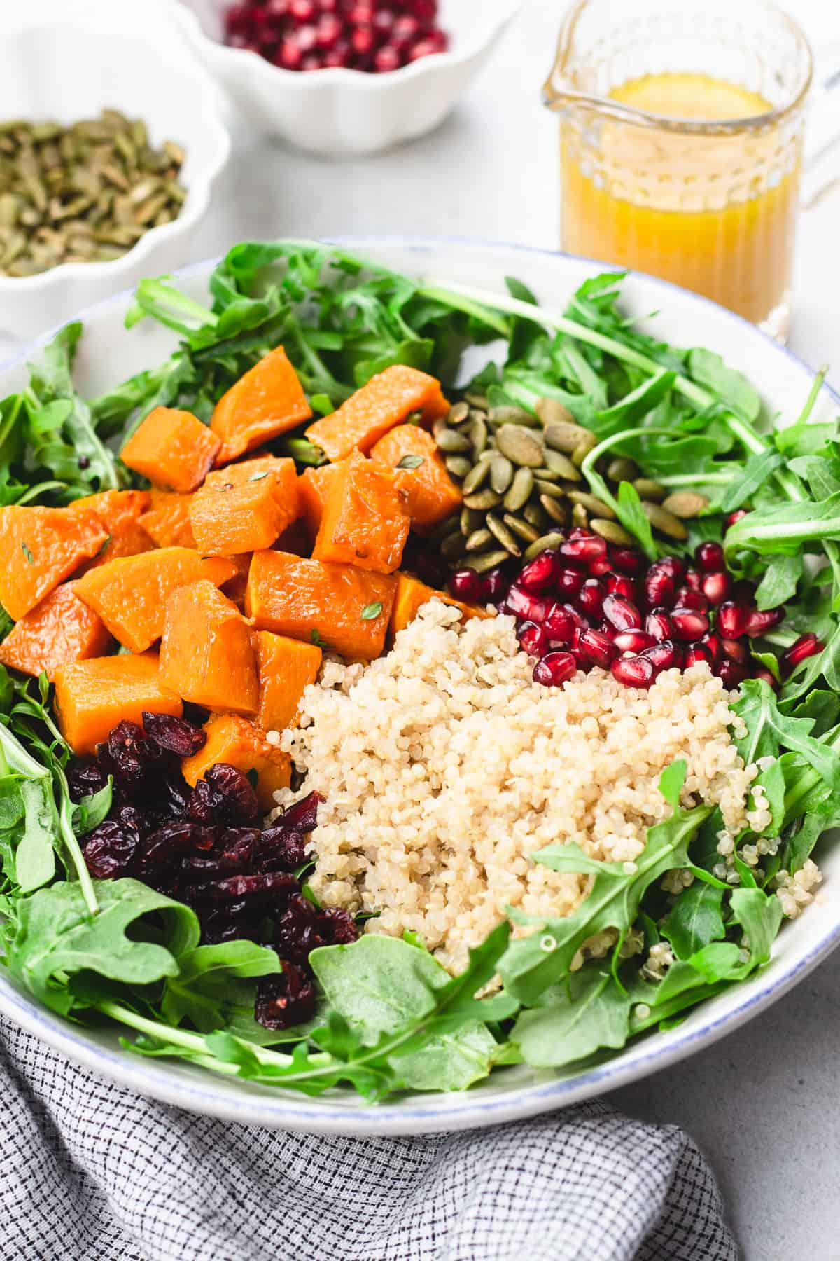 Butternut Squash Quinoa Salad in a white bowl before mixing.