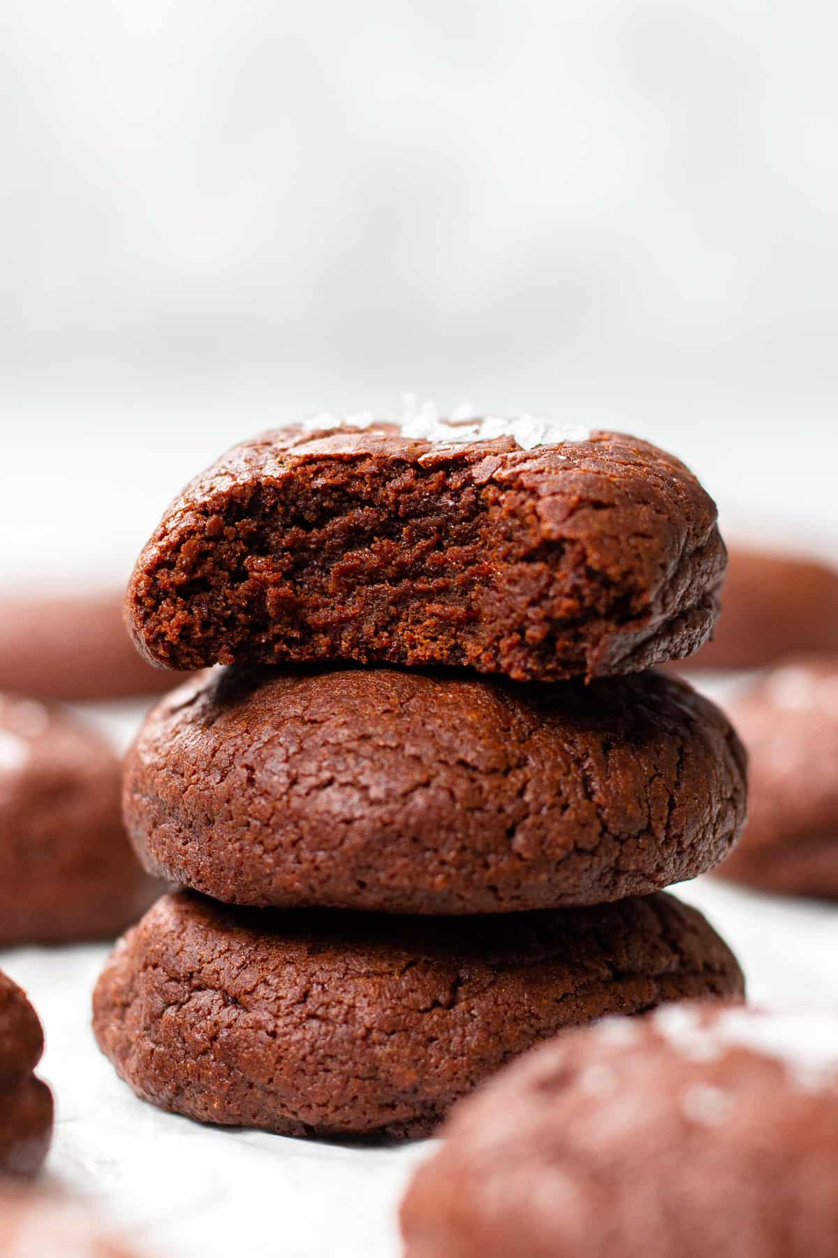 A stack of brownie cookies on white table.