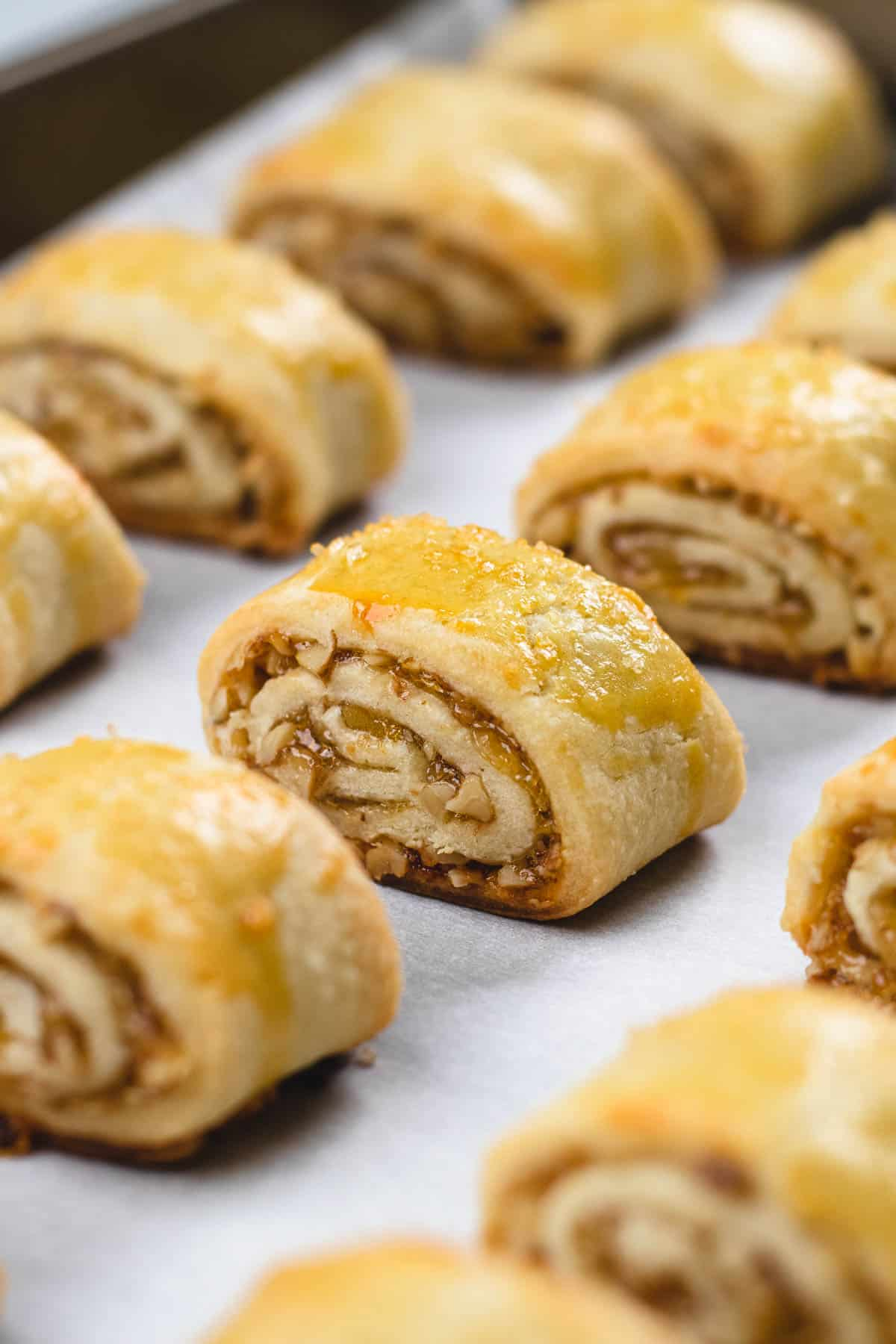 Baked Rugelach cookies on a baking sheet.