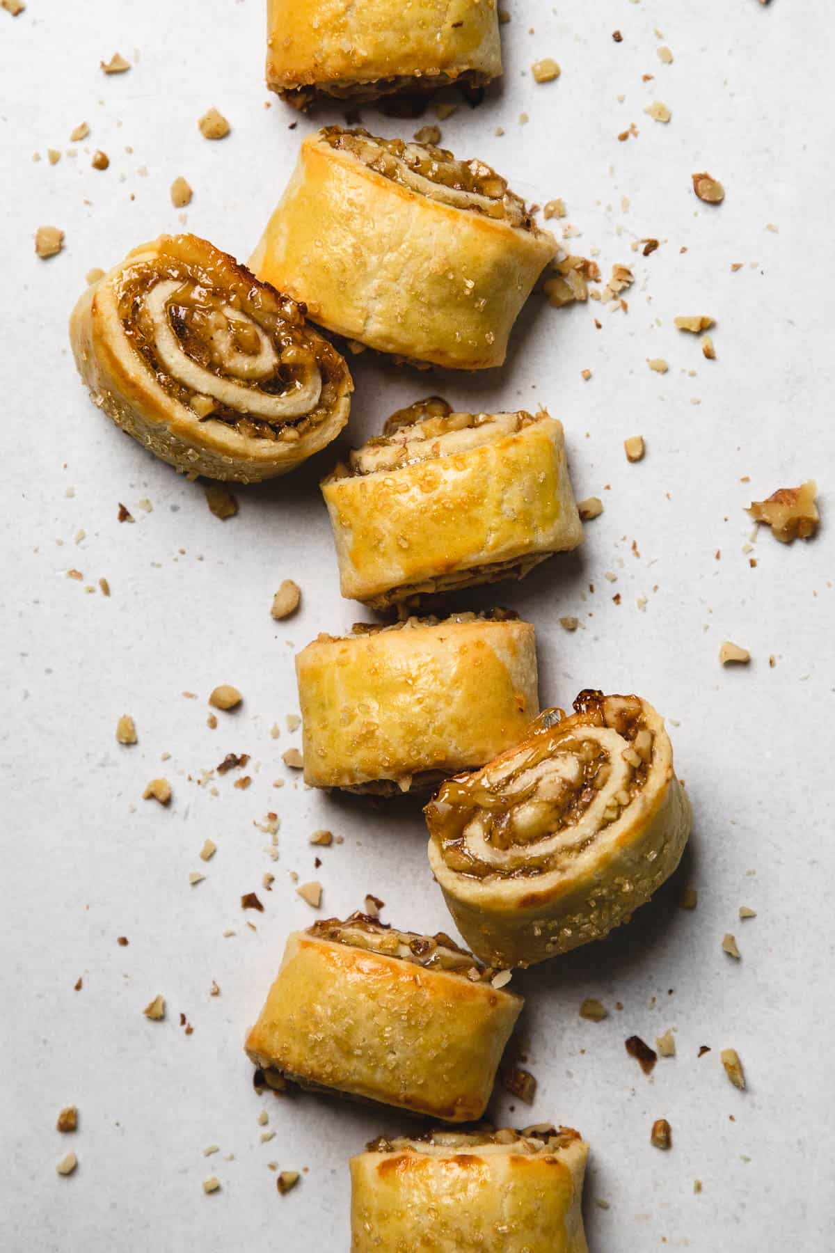 Baked Apricot Rugelach cookies in a line on a table.