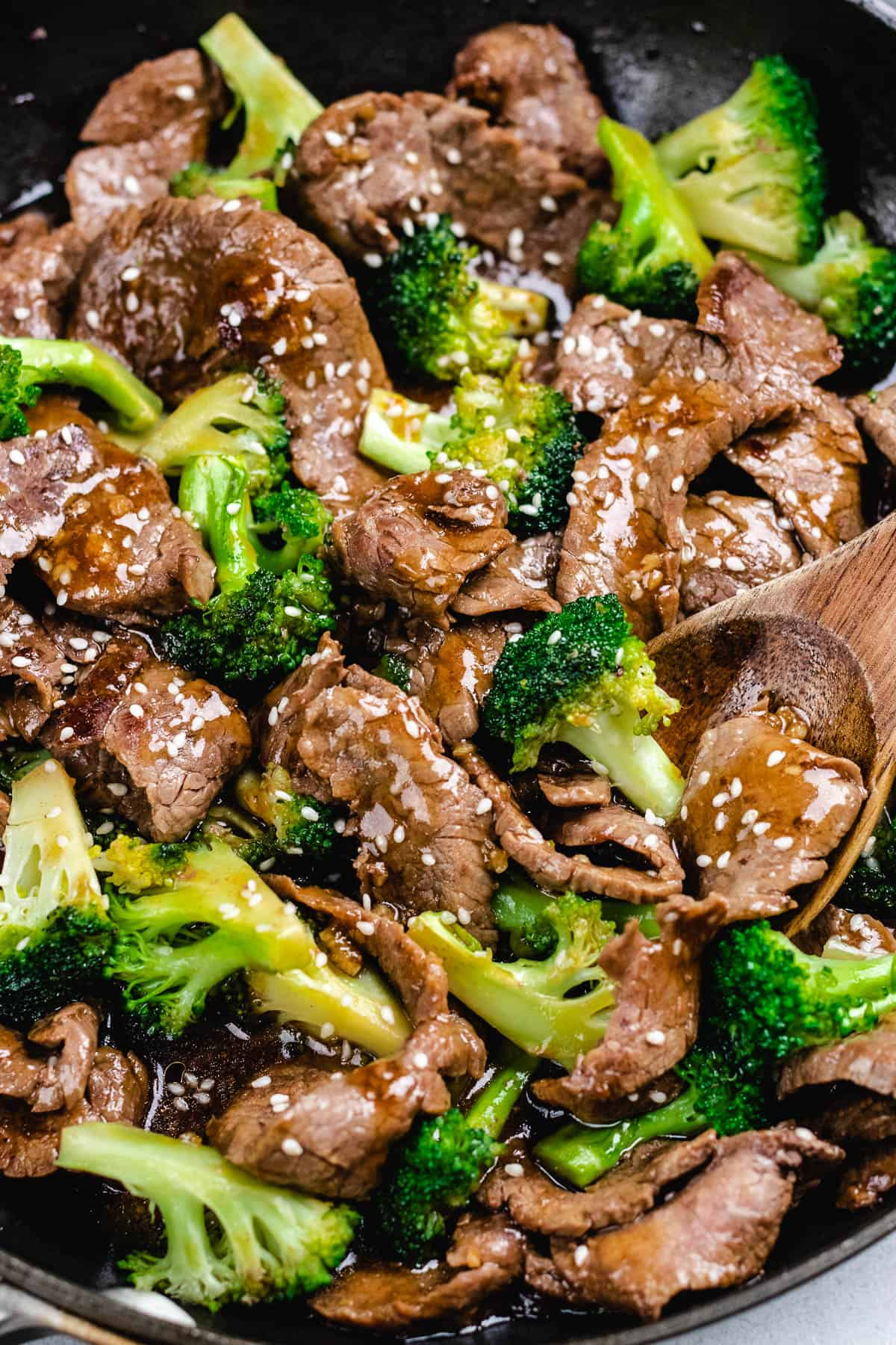 Beef and Broccoli in a skillet, topped with sesame seeds.