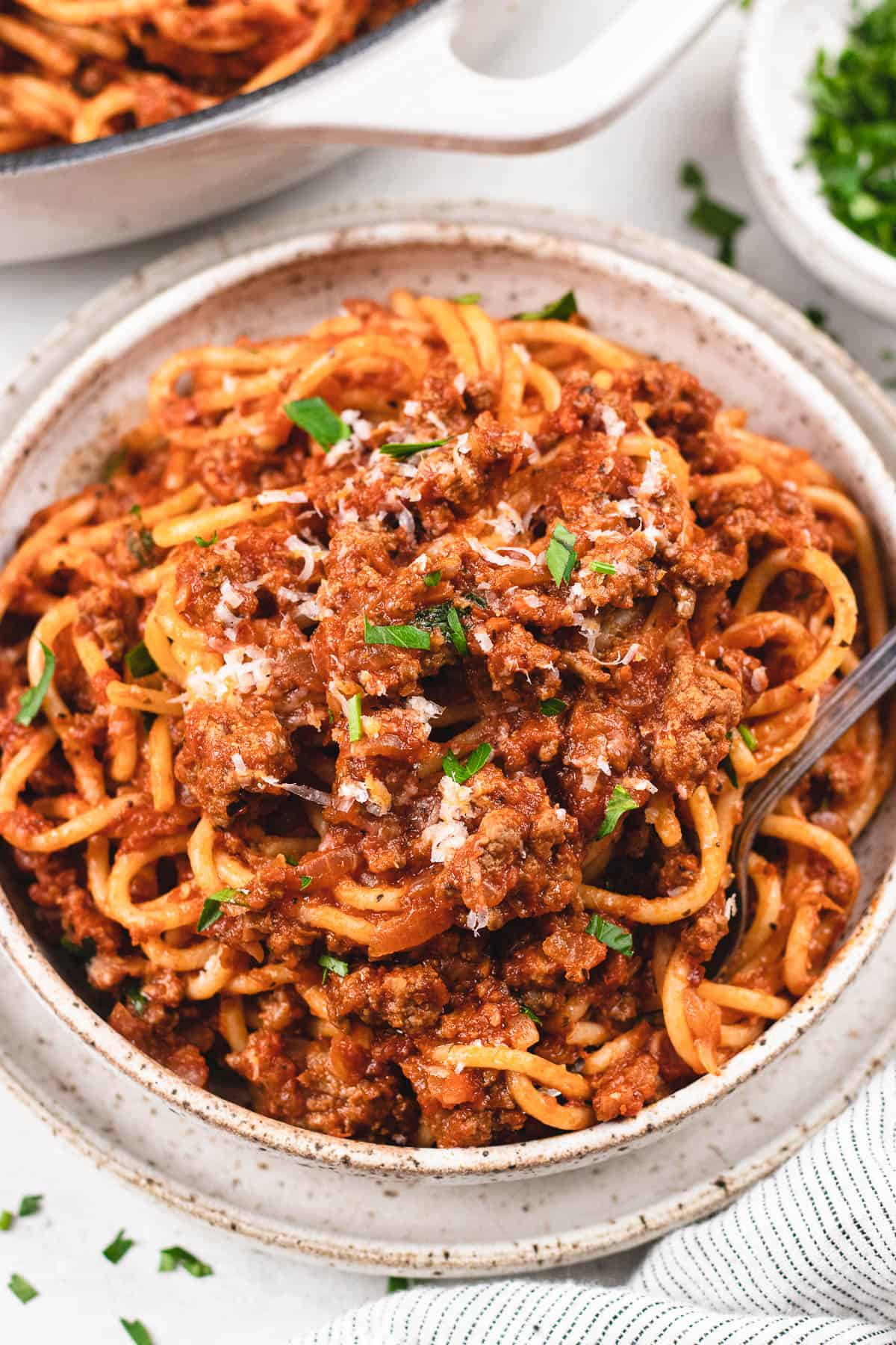 Spaghetti Bolognese in a bowl with a fork.