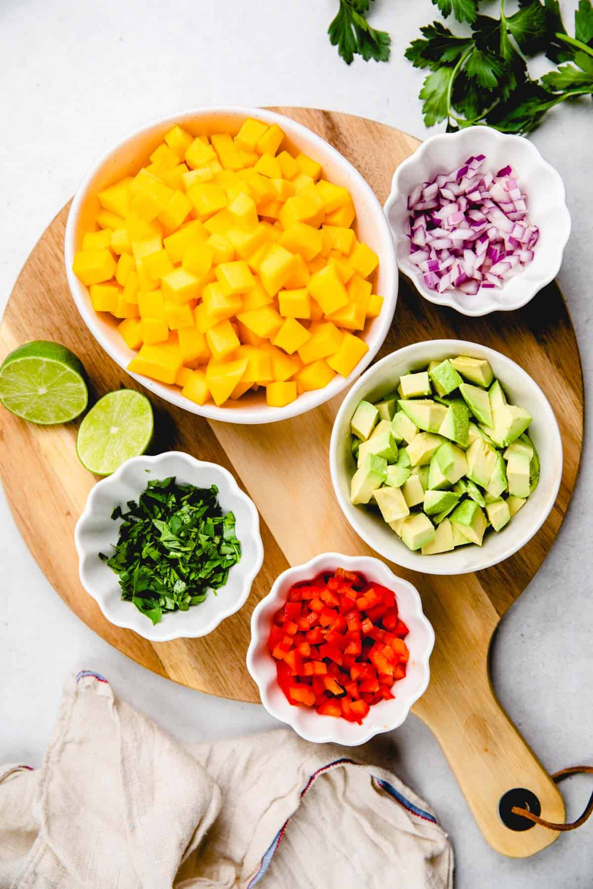 Chopped Ingredients for mango avocado salsa in separate bowls.