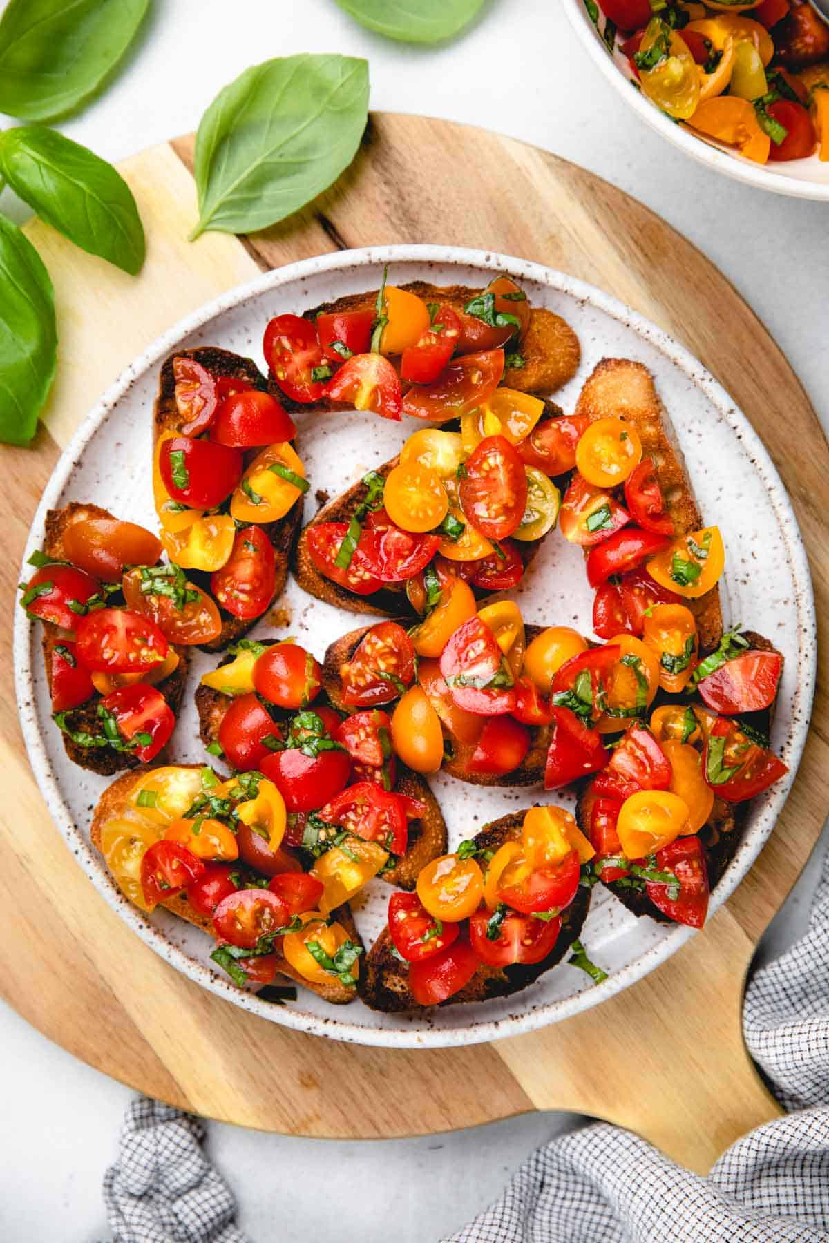 Cherry tomato bruschetta on a white plate.