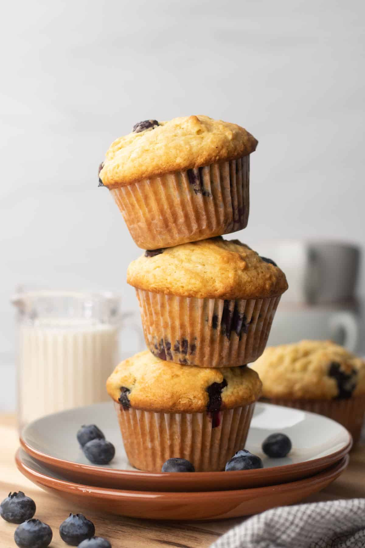 Three Blueberry muffins on top of each other.