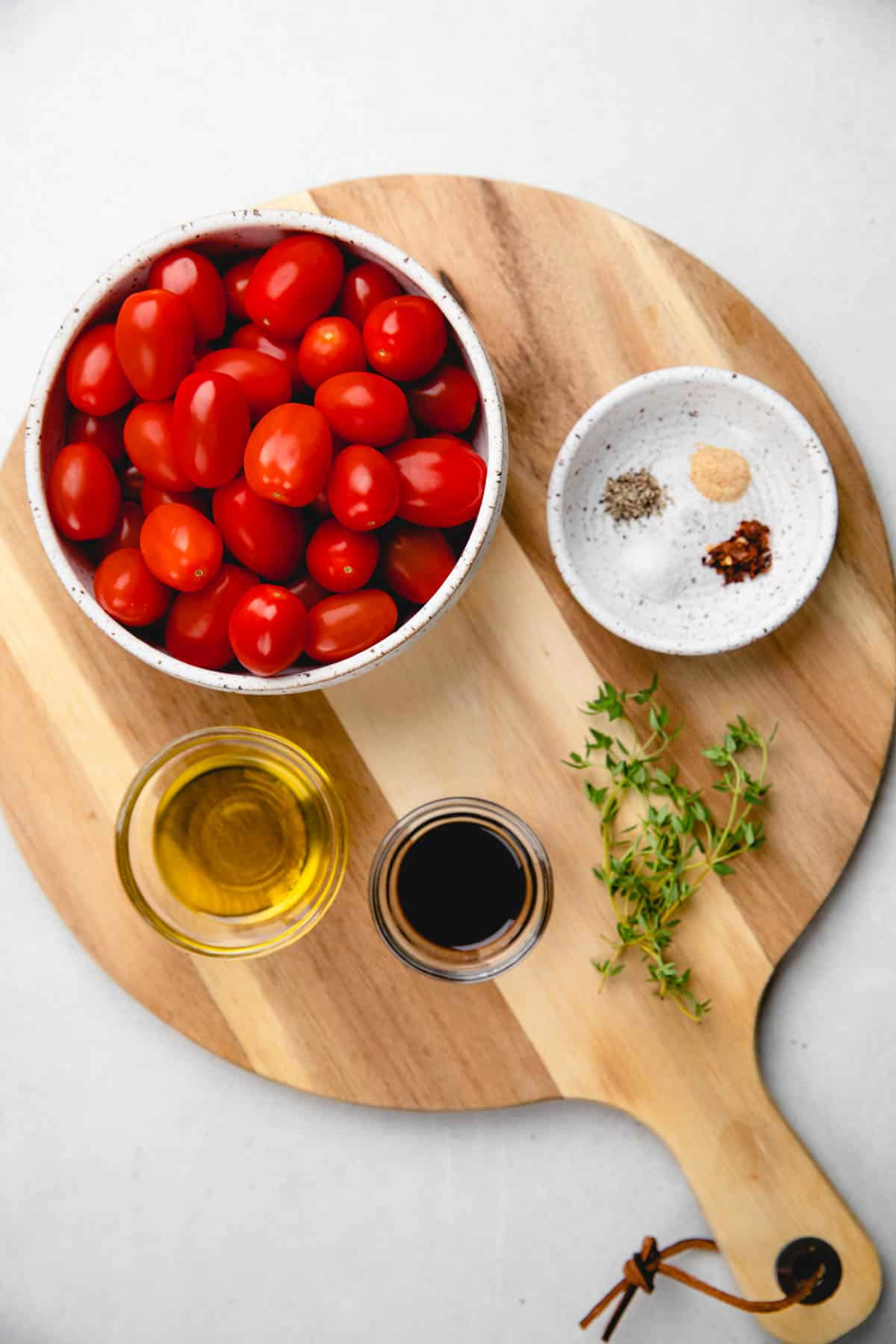 Ingredients for roasted cherry tomatoes.
