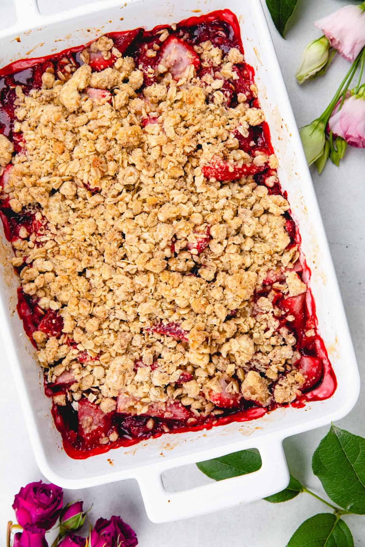 Strawberry Crumble in a white baking pan.